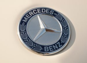 Mercedes Benz logo on an automobile. Mercedes Benz is a German automobile manufacturing company.