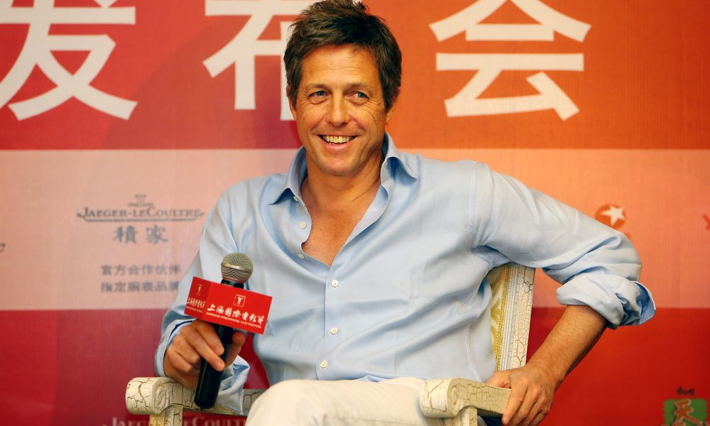 English actor Hugh Grant smiles at a press conference for his movie, The Rewrite, during the 17th Shanghai International Film Festival in Shanghai, China, 15 June 2014.