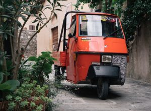 Castiglione d'Orcia, Italy - August 18 2020: Piaggio Ape 50, an Italian three-wheeled light commercial vehicle based on the Vespa Scooter.