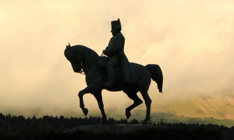 Sculpture of Napoleon on his horse by cloudy sunset, Laffry, France. It was realized by Fremiet artist.