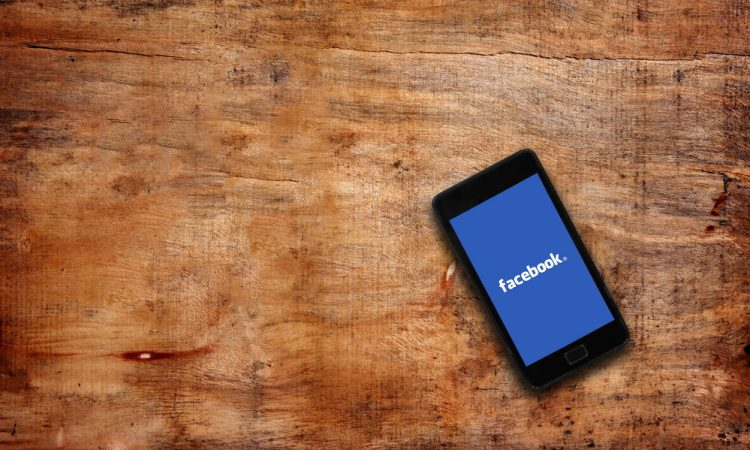 Melbourne,Australia-May 7,2015: Facebook page on the smartphone on table. Facebook is very well know social networking service founded in 2004 by Mark Zuckerberg